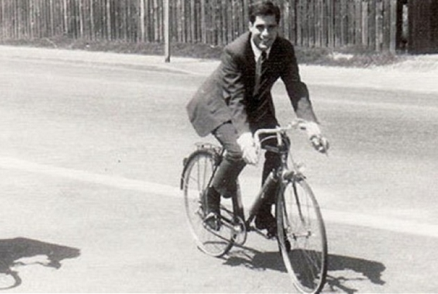 Mitt Romney hid out in France during the Vietnam War, dress shoes and toe clips, perhaps a staged photo?