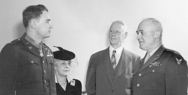 Major Jay Zeamer gets his Medal of Honor from General Hap Arnold in front of mom and day
