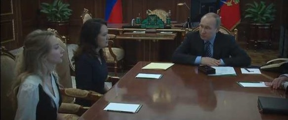 Putin meets the widows of the two Russian journalists killed to explain why the swap had to be done.