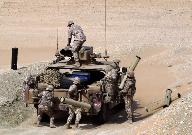 UAE soldiers load their military vehicle with rockets during manoeuvres with the French army in the desert of Abu Dhabi May 2, 2012. AFP PHOTO/KARIM SAHIB / AFP / KARIM SAHIB