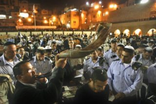 A Jewish orthodox man blows a 'Shofar' (ram's horn) while Hundreds of Jews , pray all night for forgiveness ( Selichot), at the the Western Wall, the holiest place where Jews can pray, in Jerusalem's Old City before the holiday of Rosh Hashanah.