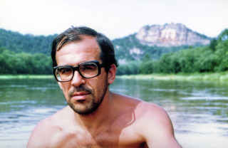 A younger Sergei Lavrov, swimming with glasses on