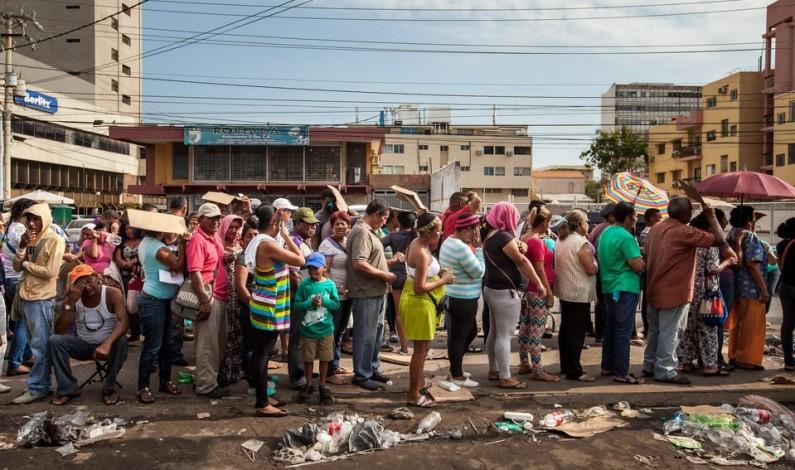 Venezuela police fire tear gas at protesters demanding food