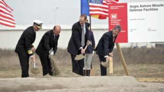 From left US Vice Admiral James D Syring, Romanian President Traian Basescu , US Undersecretary of Defense for Policy James N Miller, and Romanian Defense Minister Mircea Dusa shovel sand during the official ground breaking ceremony of an U.S. Aegis Ashore missile defense base in Deveselu, Romania, Oct. 28, 2013 (file photo)