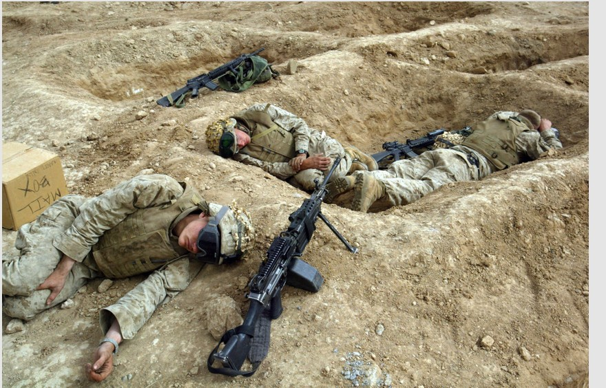 """Staged """"hearts and minds"""" psyop photo of Americans sleeping in their """"fox holes"""" 2004 Fallujah"""