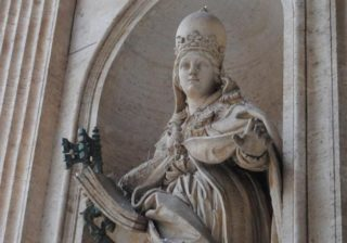 The statue that still stands in Rome is Joanna with a papal crown