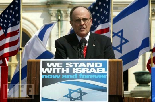 "Giuliani ""stood with Israel"" and helped murder 3000 Americans on 9/11"