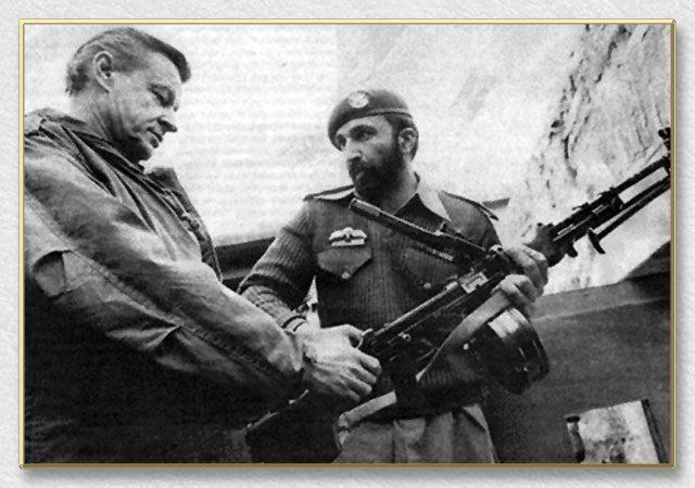 Osama bin Ladin giving Ziggy a gun tour
