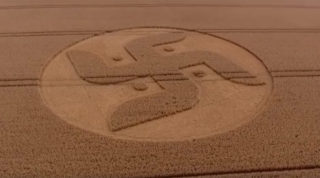 A 180ft-wide crop circle cut in a Nazi swastika-like design has mysteriously appeared in a field in Wiltshire, southwest England, sparking conspiracy theorists (unsurprisingly) to speculate about alien involvement.