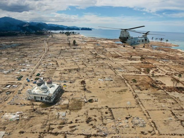 A U.S Marine helicopter flies over Northern Sumatra, Indonesia just a few days after the tsunami
