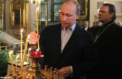 Putin in a Russian church