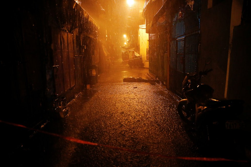An alley in Manila with drug businesses.