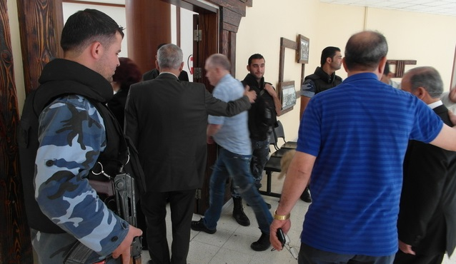 Monitors meeting Homs governor on election day, guards literally in every hallway... June, 2012