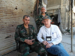 Jim Dean at checkpoint in Homs, Syria, on election day, June, 2012