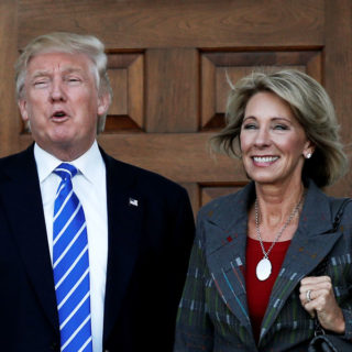 Betsy Devos with the man to be