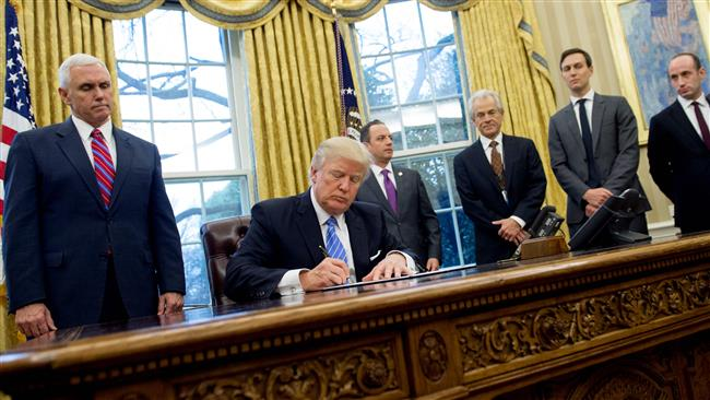 Trump signs new executive order on immigration