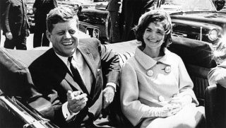 On this 22nd day of November in 1963, John Fitzgerald Kennedy, the 35th president of the United States, is assassinated while traveling through Dallas, Texas, in an open-top convertible.