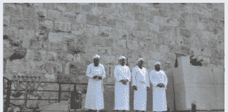 Kohanim stand in front of the altar – constructed for use in the Third Temple – and other vessels. (Credit: Adam Eliyahu Berkowitz/Breaking Israel News)